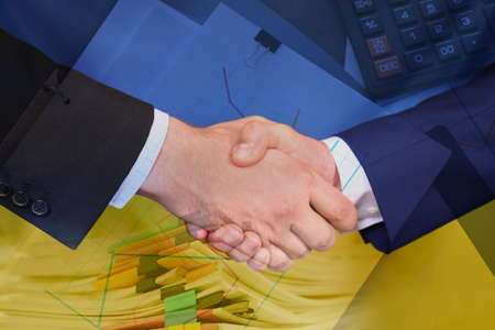 Multiple exposure of documents, business partners shaking hands and Ukrainian national flag, closeup