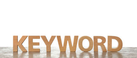 Word KEYWORD made of wooden letters on light background. Space for text
