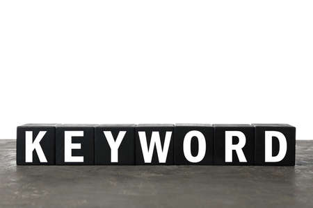 Black cubes with word KEYWORD on gray table