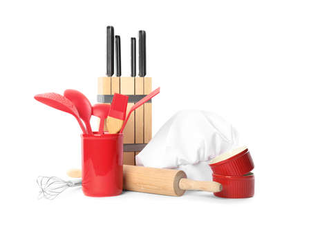 Set of different cooking utensils and chef's hat on white background Stock Photo