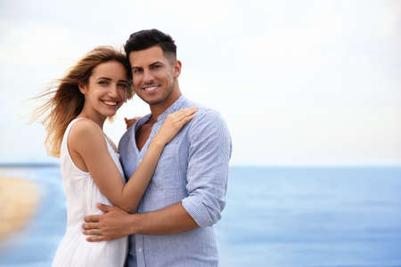 Happy couple on beach, space for text. Romantic walk