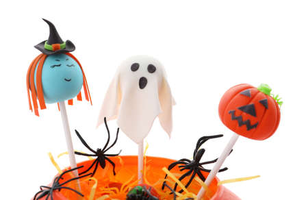 Delicious Halloween themed cake pops on white background
