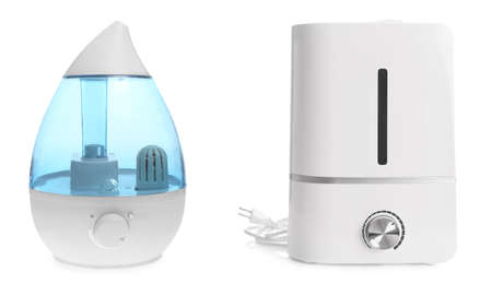 Two modern air humidifiers on white background