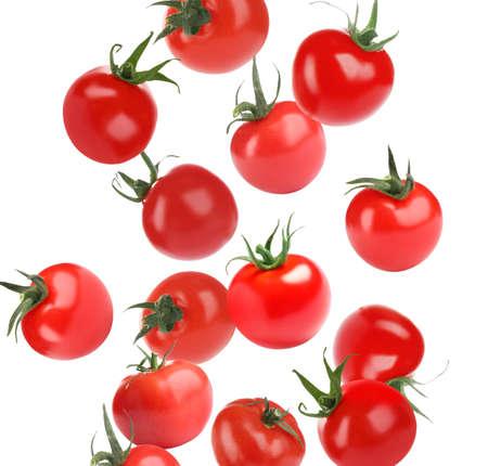 Many whole tomatoes falling on white background