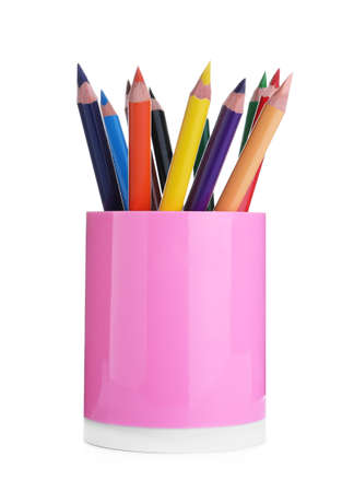 Many colorful pencils in pink holder isolated on white. School stationery