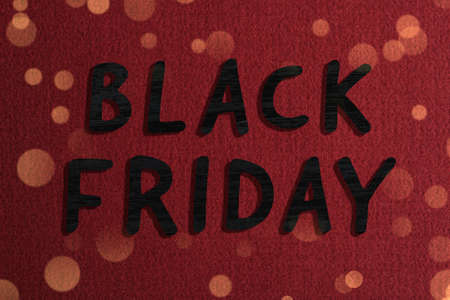 Phrase Black Friday and beautiful red fabric on background Stock fotó - 154496312