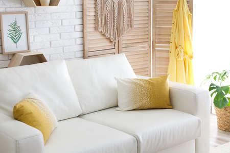 Comfortable white sofa in modern room. Interior design