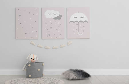 Cute posters on wall in baby room interior Stock fotó