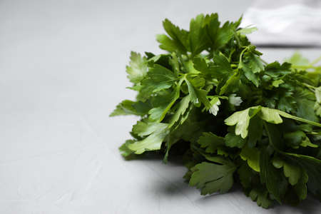 Fresh green parsley on table, closeup. Space for text Stock Photo