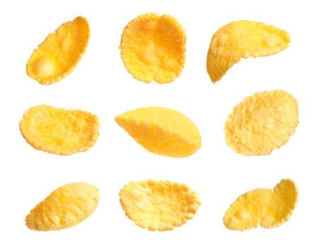 Set of tasty crispy corn flakes on white background