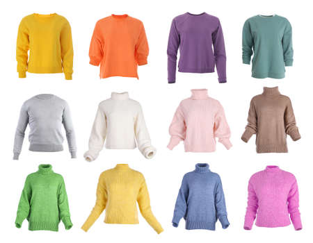 Set of different stylish warm sweaters on white background