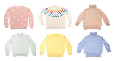 Set of stylish sweaters on white background