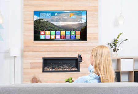 Woman watching smart TV in living room