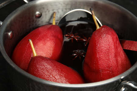 Poaching pears in mulled wine, closeup view