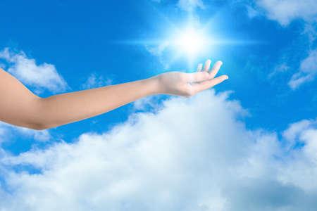 Bright light in hand, closeup. Solar energy concept Archivio Fotografico