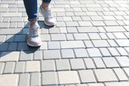 Woman walking outdoors, closeup with space for text. Choosing way concept.