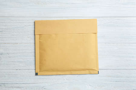 Kraft paper envelope on white wooden background, top view Stock Photo