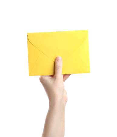 Woman holding yellow paper envelope on white background, closeup