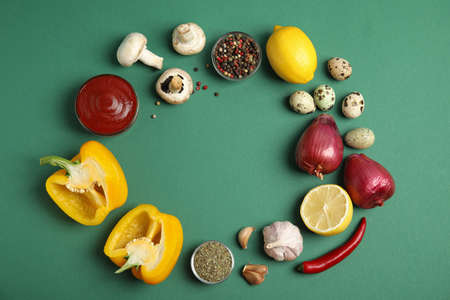 Frame of ingredients for cooking on green background, flat lay. Space for text Stock fotó