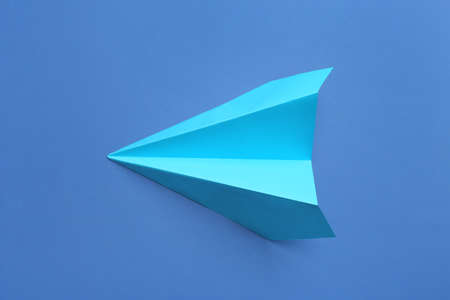 Paper plane on blue background, top view Stock Photo