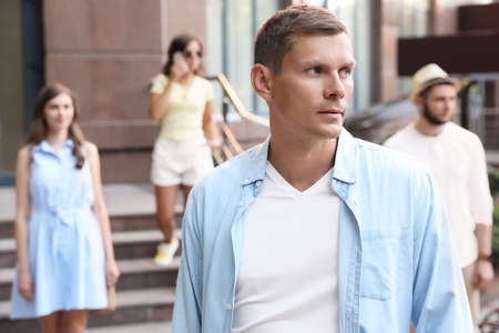 Handsome man walking on modern city street Archivio Fotografico