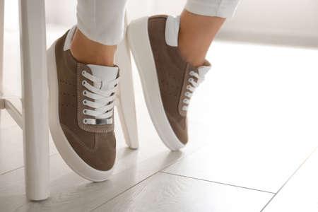 Woman wearing comfortable stylish shoes indoors, closeup