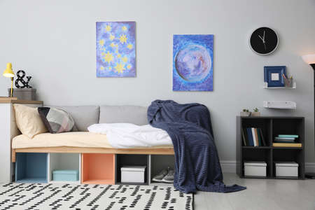 Modern teenager's room interior with comfortable bed and stylish design elements Archivio Fotografico