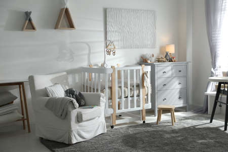 Baby room interior with crib and armchair. Idea for design