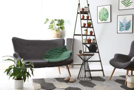 Stylish living room interior with decorative ladder Stock fotó