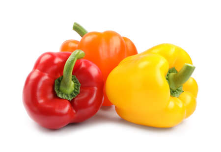 Fresh ripe bell peppers on white background