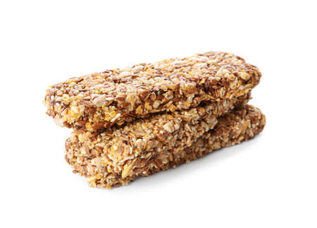 Crunchy granola bars on white background. Healthy snack