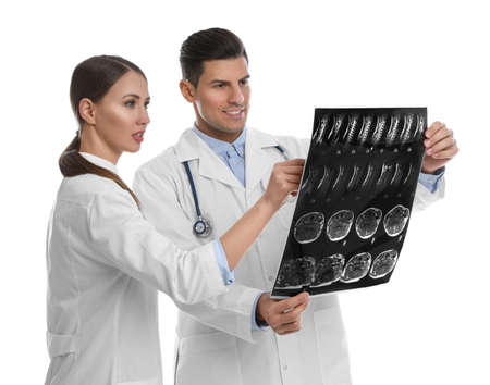 Orthopedists working with X-ray picture on white background