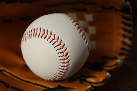 Professional leather baseball ball and glove, closeup