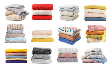 Set of folded and stacked sweaters on white background