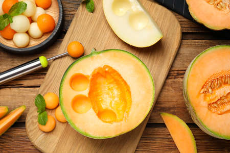 Flat lay composition with melon balls on wooden table Stock Photo