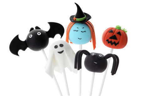 Set of Halloween themed cake pops on white background