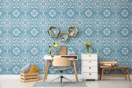 Modern room interior with furniture near patterned wallpapers Banco de Imagens