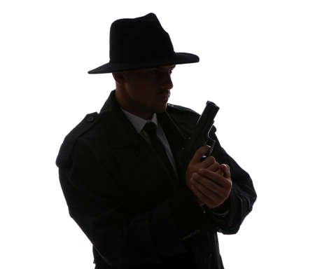 Old fashioned detective with gun on white background Stock fotó