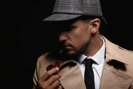 Old fashioned detective with smoking pipe on dark background, closeup