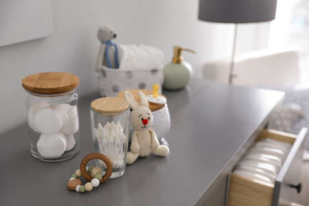 Baby accessories and toys on table in room Stock fotó