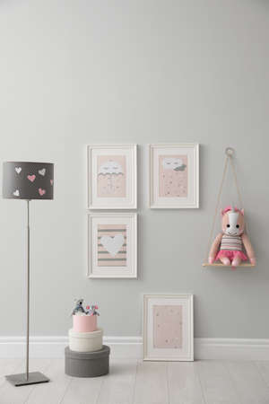Children's room interior with floor lamp and cute pictures on wall Standard-Bild