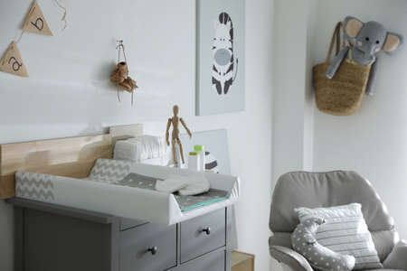 Modern changing table in baby room interior