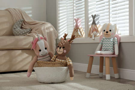 Funny toy unicorn, dog and deer in children's room. Interior design