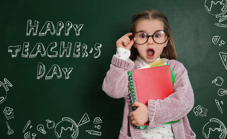 Emotional little child wearing glasses near chalkboard with text Happy Teacher's Day