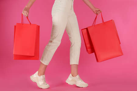 Woman with shopping bags on pink background, closeup. Black Friday Sale Stock fotó - 154756845