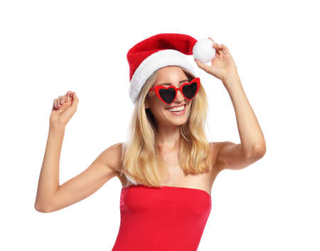 Young woman wearing Santa Claus hat on white background. Christmas vacation