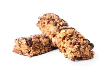 Crunchy granola bars with chocolate on white background Zdjęcie Seryjne