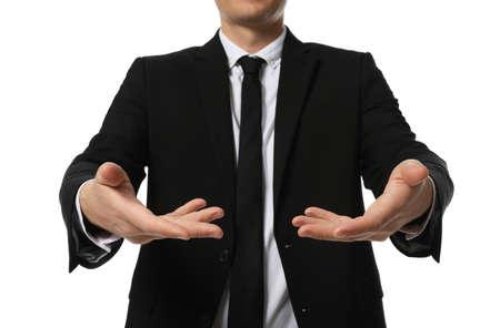 Businessman holding something on white background, closeup Foto de archivo