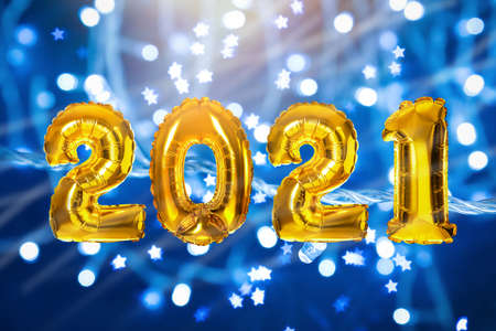 2021 New Year celebration. Creative design with bright gold balloons and blurred lights on blue background