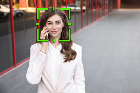 Facial recognition system identifying woman on city street